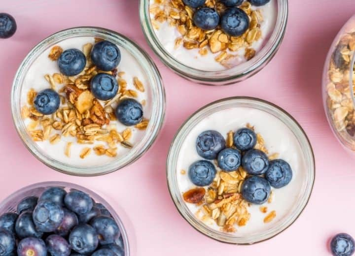 parfait topped with blueberries and granola