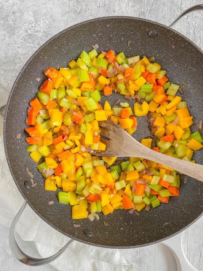 veggies sauteeing in a pan