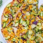 zucchini flatbread - corn flatbread on a white plate