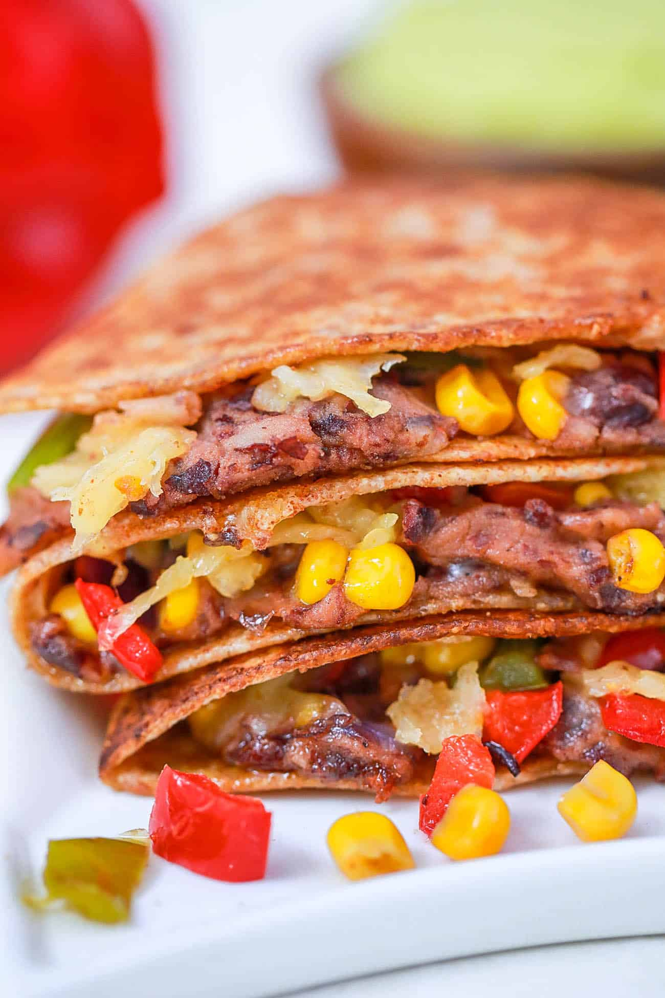 black bean quesadillas with corn and pepper jack cheese on a white plate