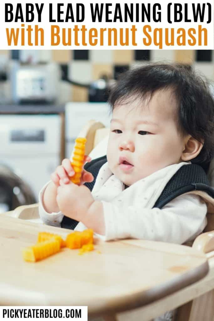baby in high chair eating small bite sized pieces of butternut squash