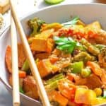 vegetable stir-fry in bowl with chop sticks