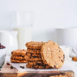 healthy oatmeal raisin cookies stacked on a white plate