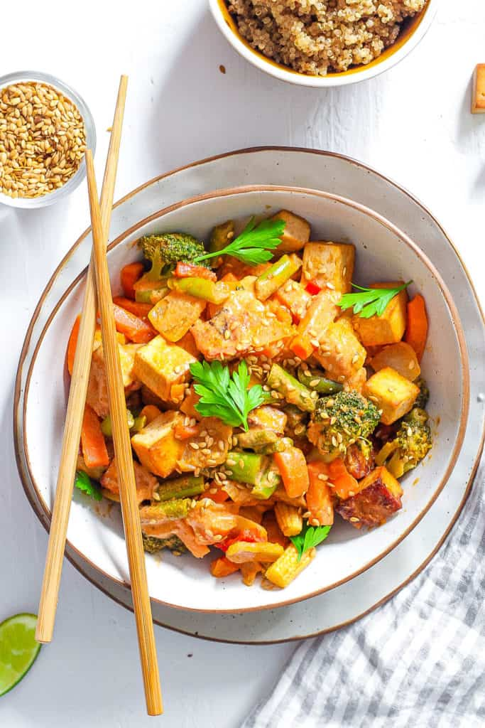 healthy vegetable stir fry recipe served in a white bowl with chopsticks