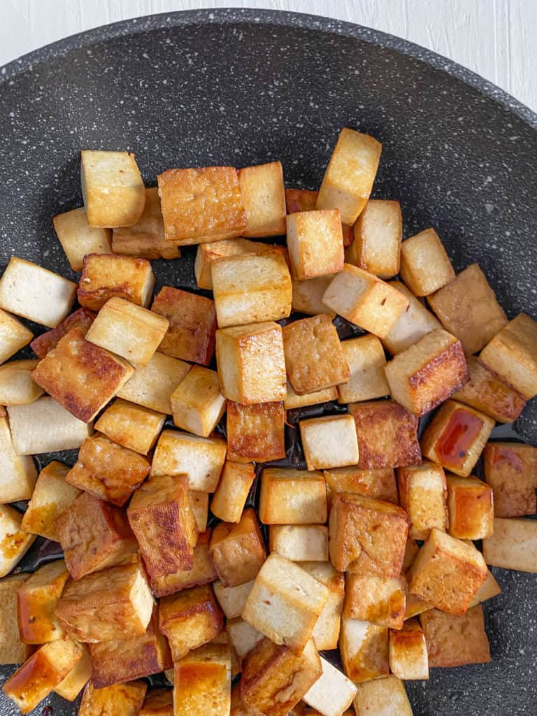 tofu sauteeing in a pot