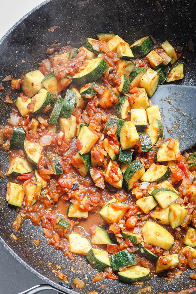 tomatoes added to pan with zucchini