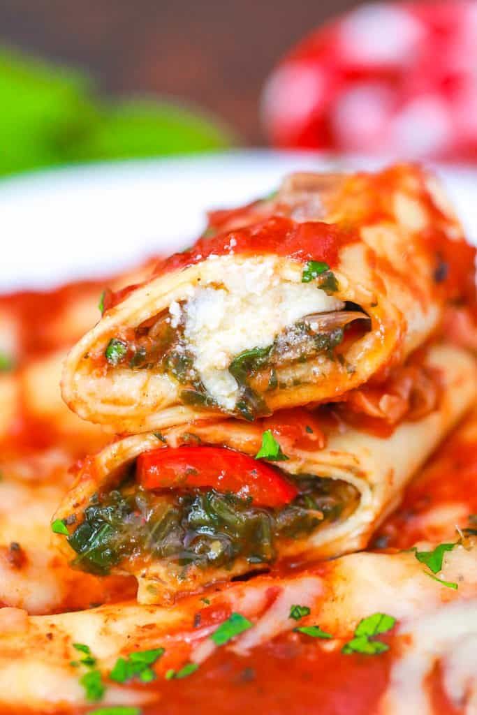 pasta rolls with pomodoro sauce on a white plate