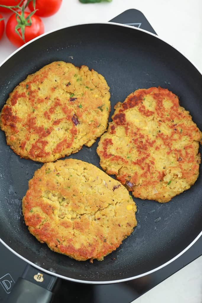 burger patties cooking on the stove
