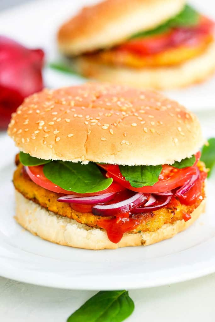 pinto bean burgers with spinach, tomato, and red onion - a classic vegetarian 4th of July recipes