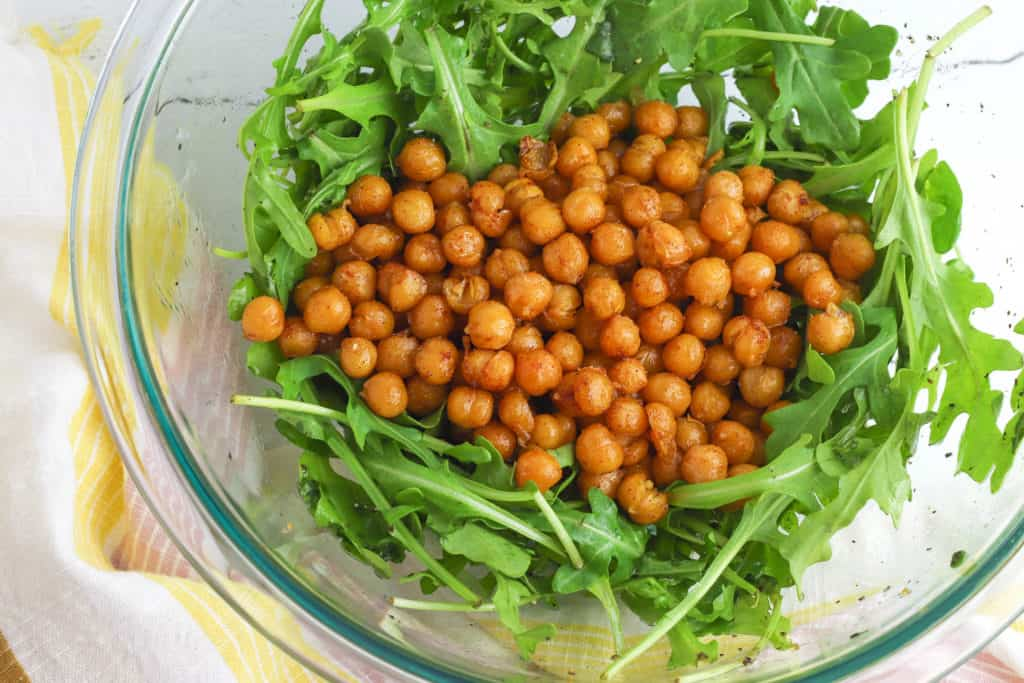 chickpeas and arugula in a bowl