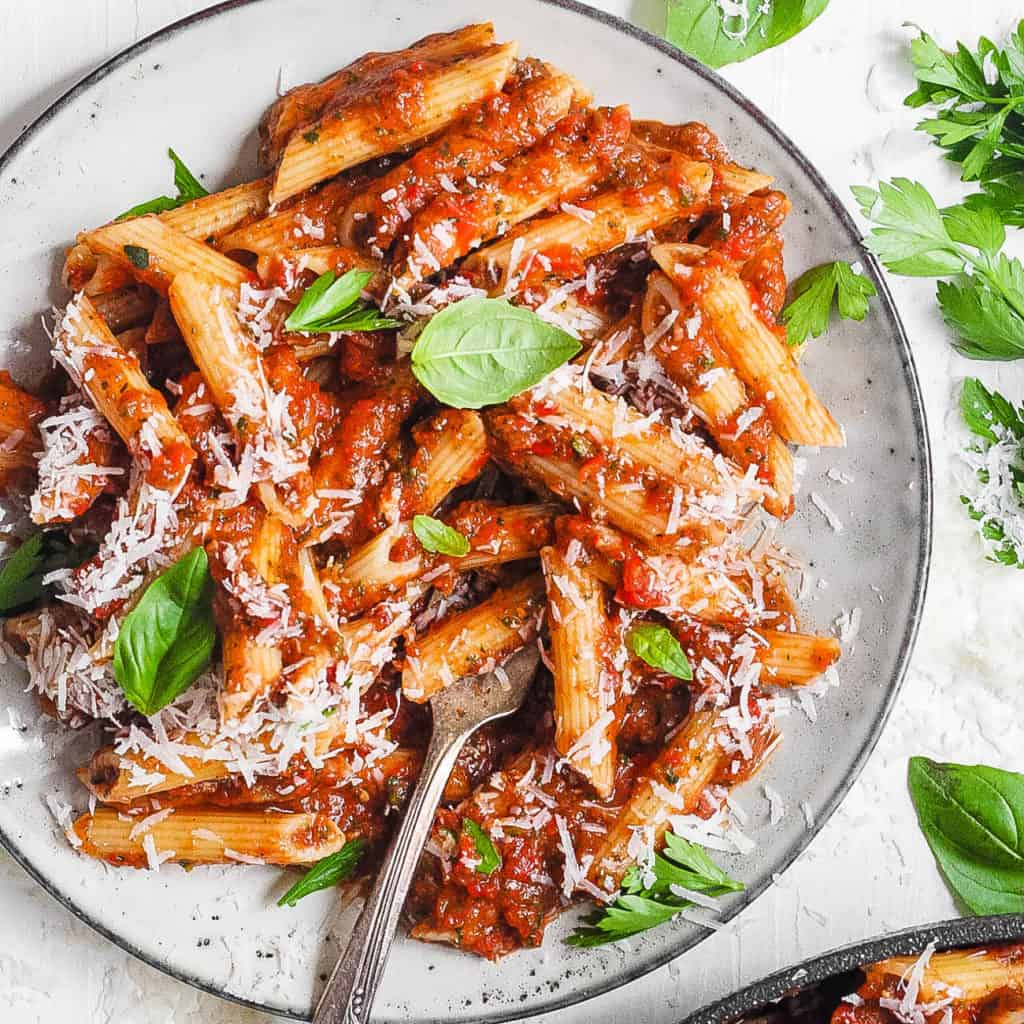 red lentil pasta served on a white plate with superfood marinara sauce