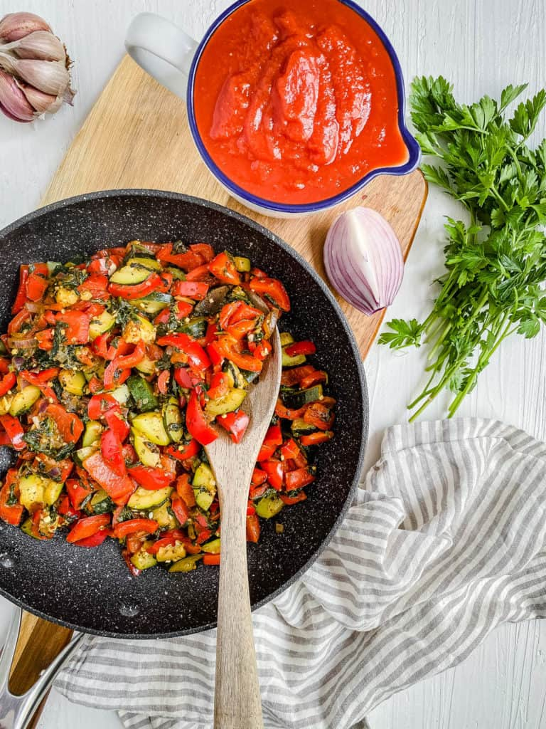 veggies for sauce cooking in a pan