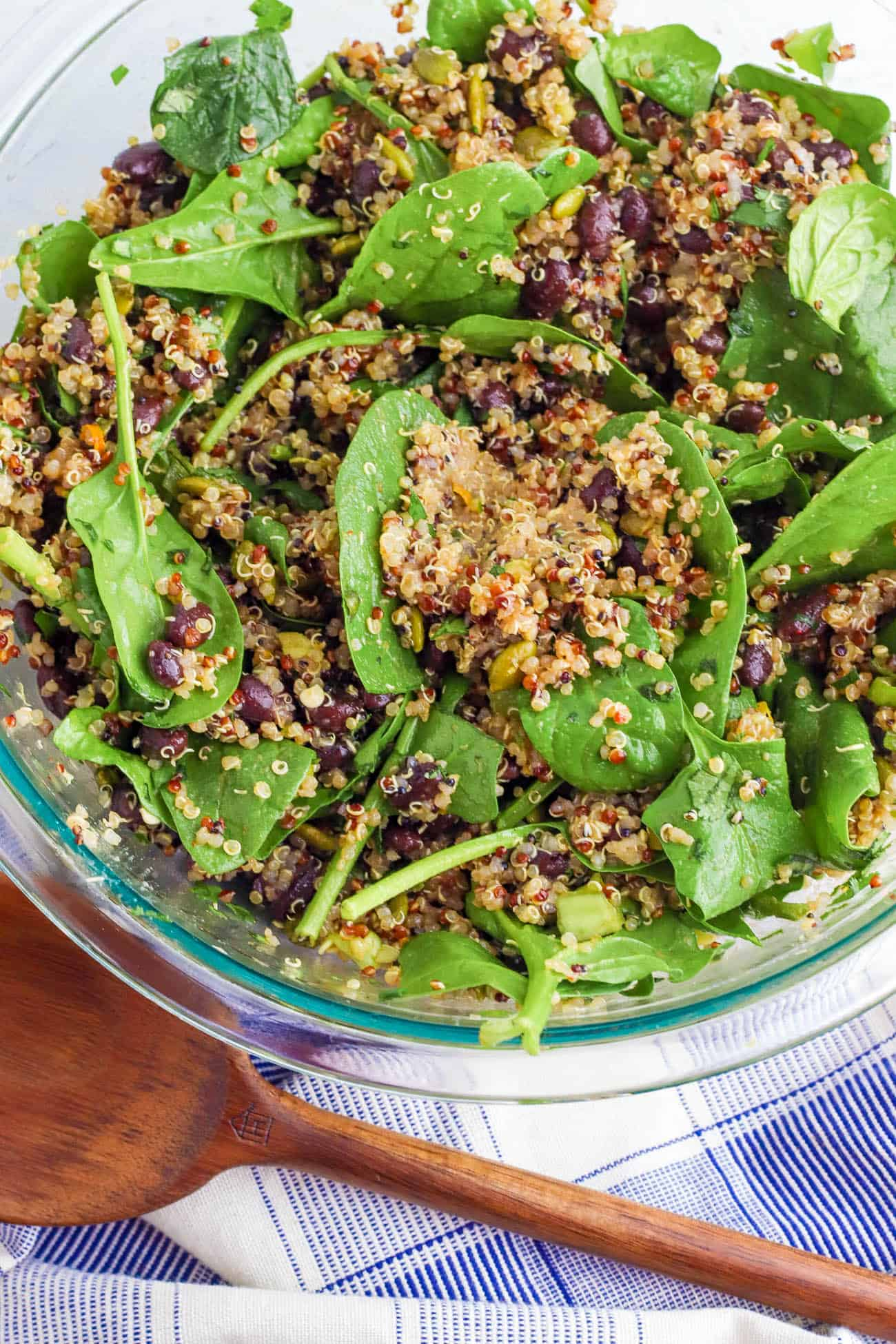 spinach and quinoa tossed in a bowl