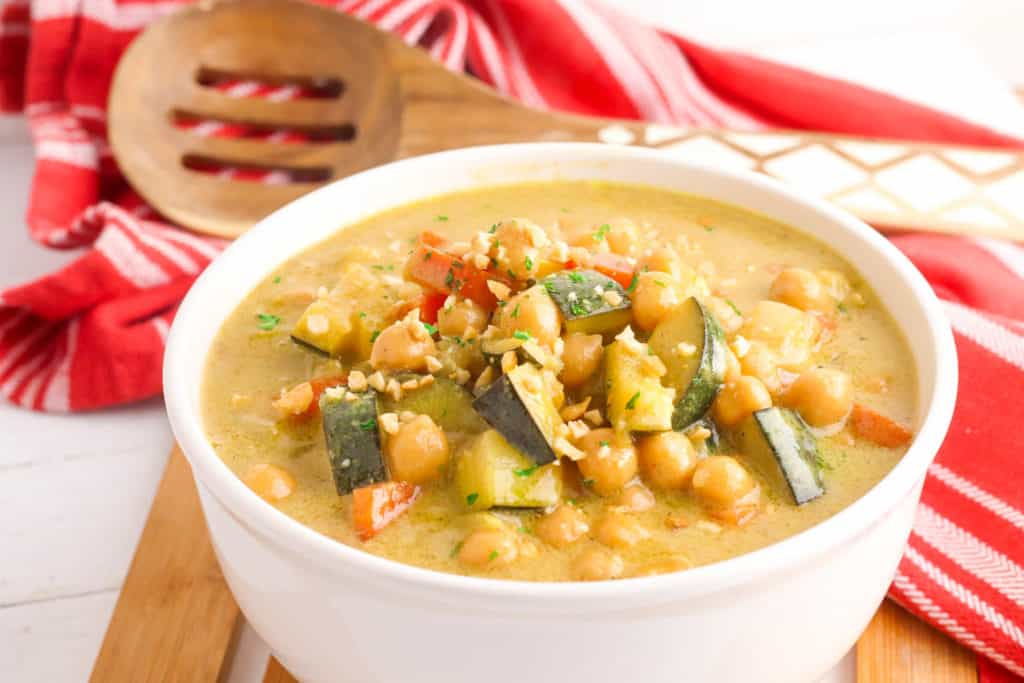 thai peanut curry with chickpeas, served in a white bowl