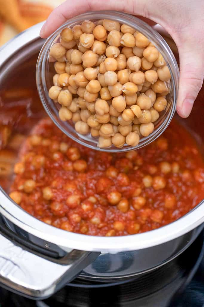 chickpeas going into a pot
