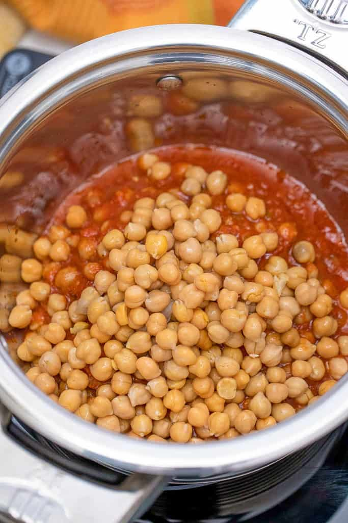 chickpeas and tomato mixture cooking in a pot