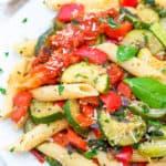 vegan pasta primavera served on a white plate