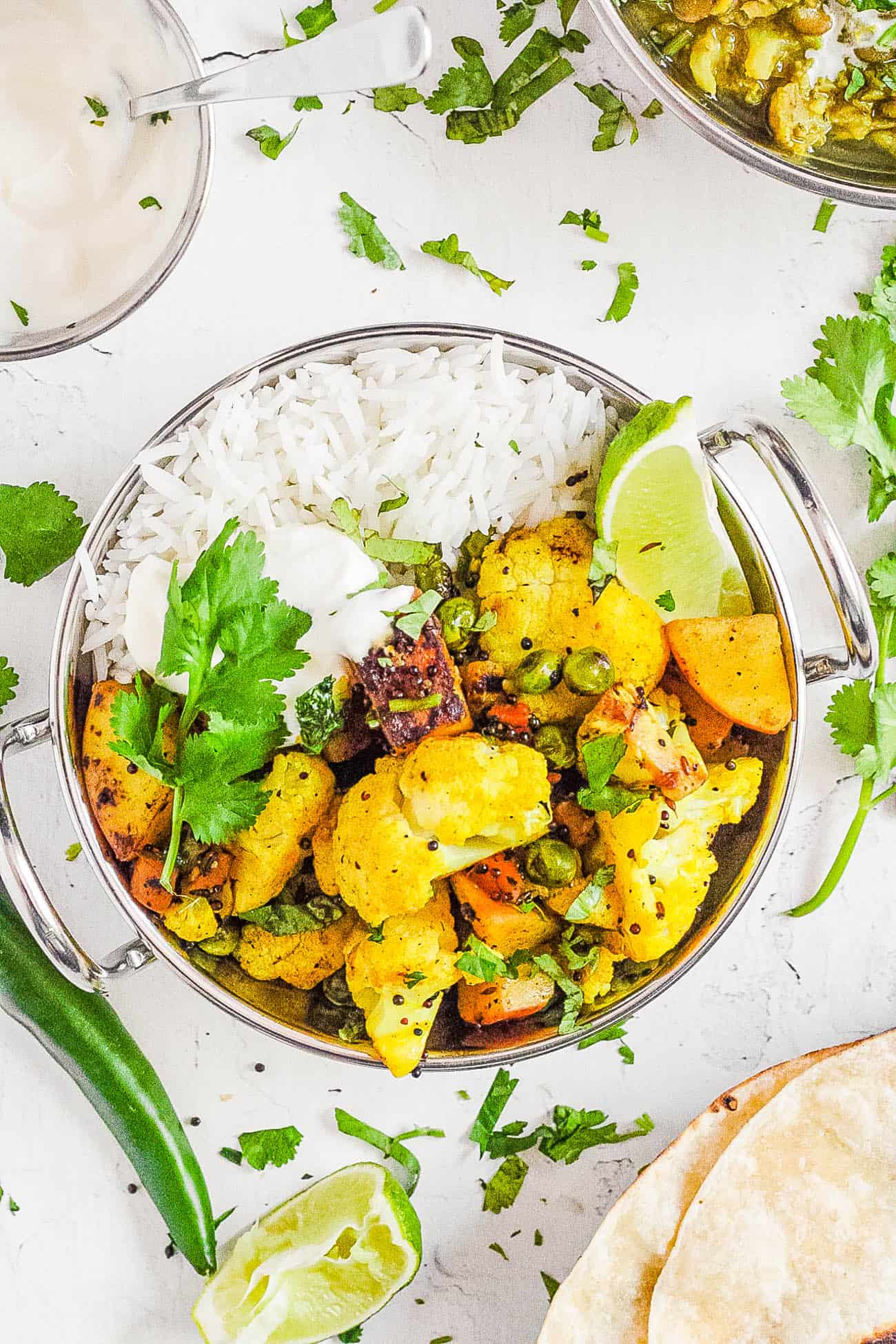 cauliflower sabji in a stainless steel bowl with rice