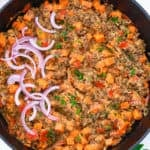 Instant Pot Lentils served with red onions and cilantro in a skillet