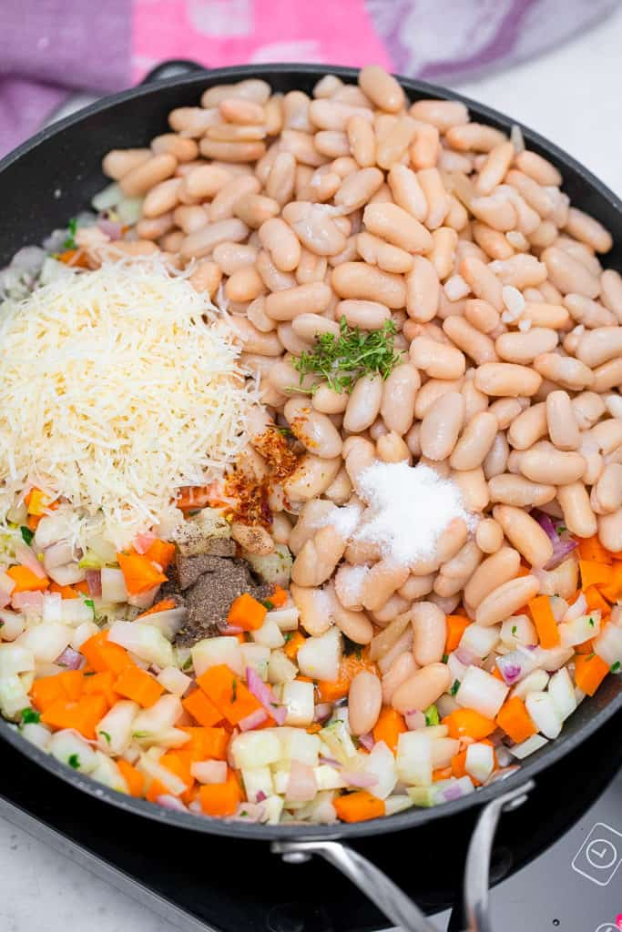 beans veggies and cheese in a pot