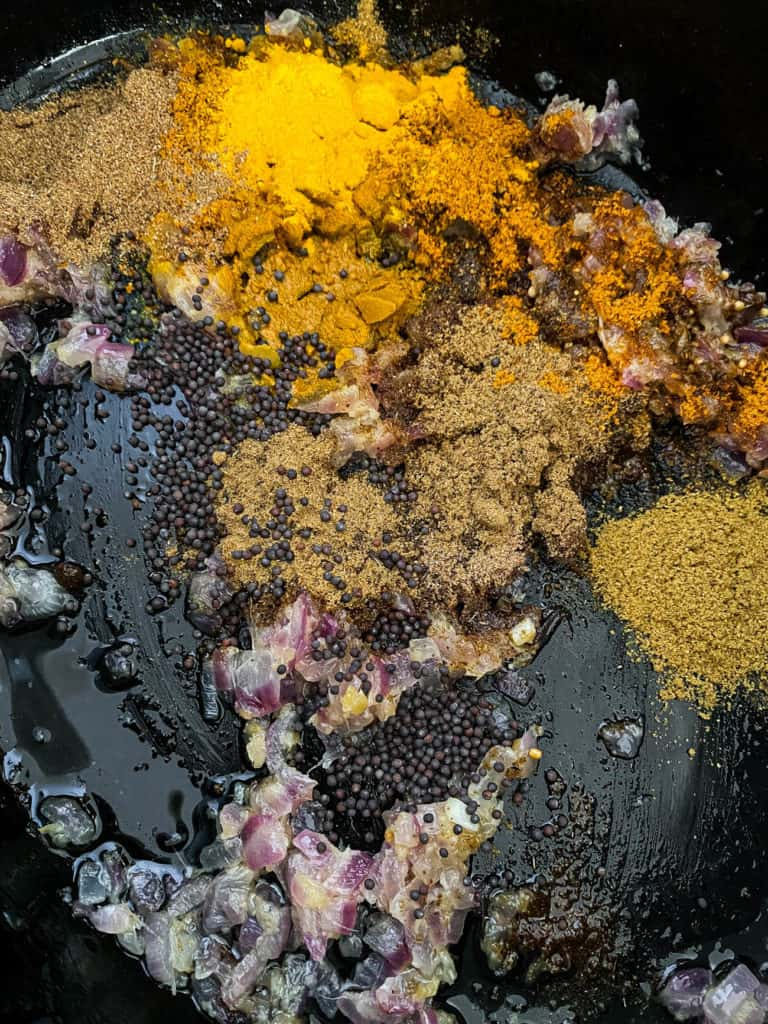 spices sauteeing in pot
