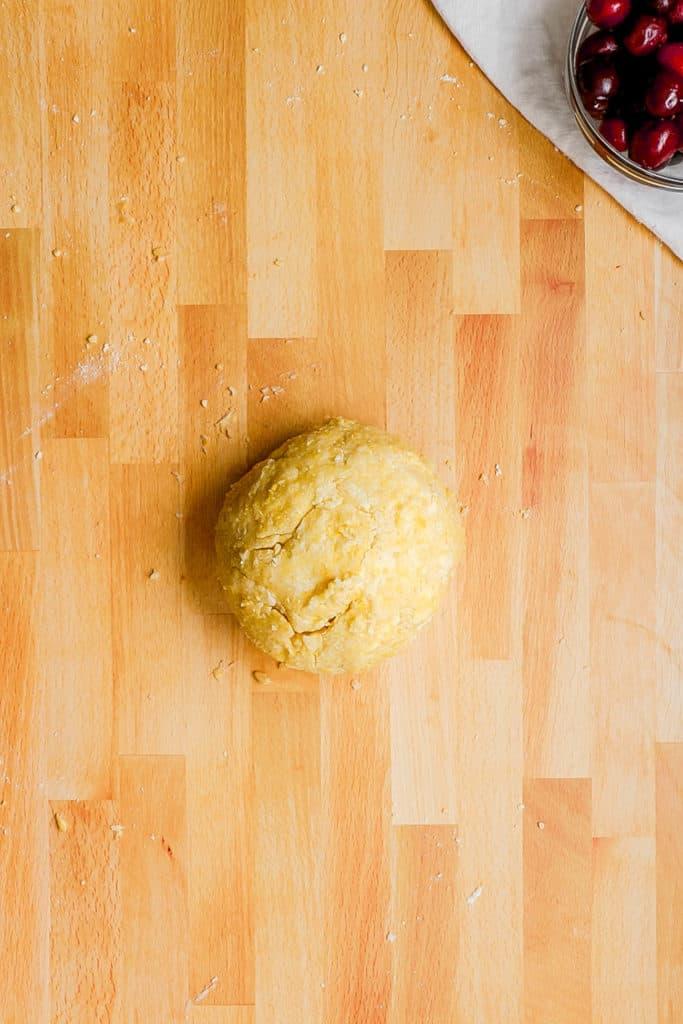dough ball on a wooden cutting board