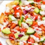 pita nachos with chickpeas, tomatoes, and cucumbers