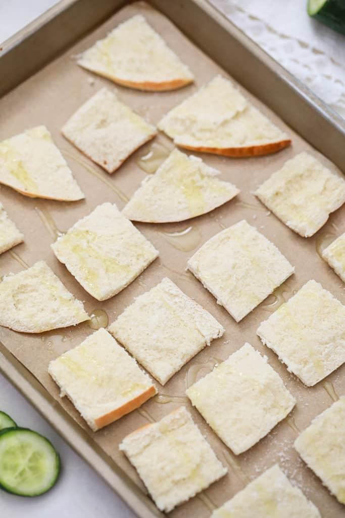 pita bread on a baking sheet