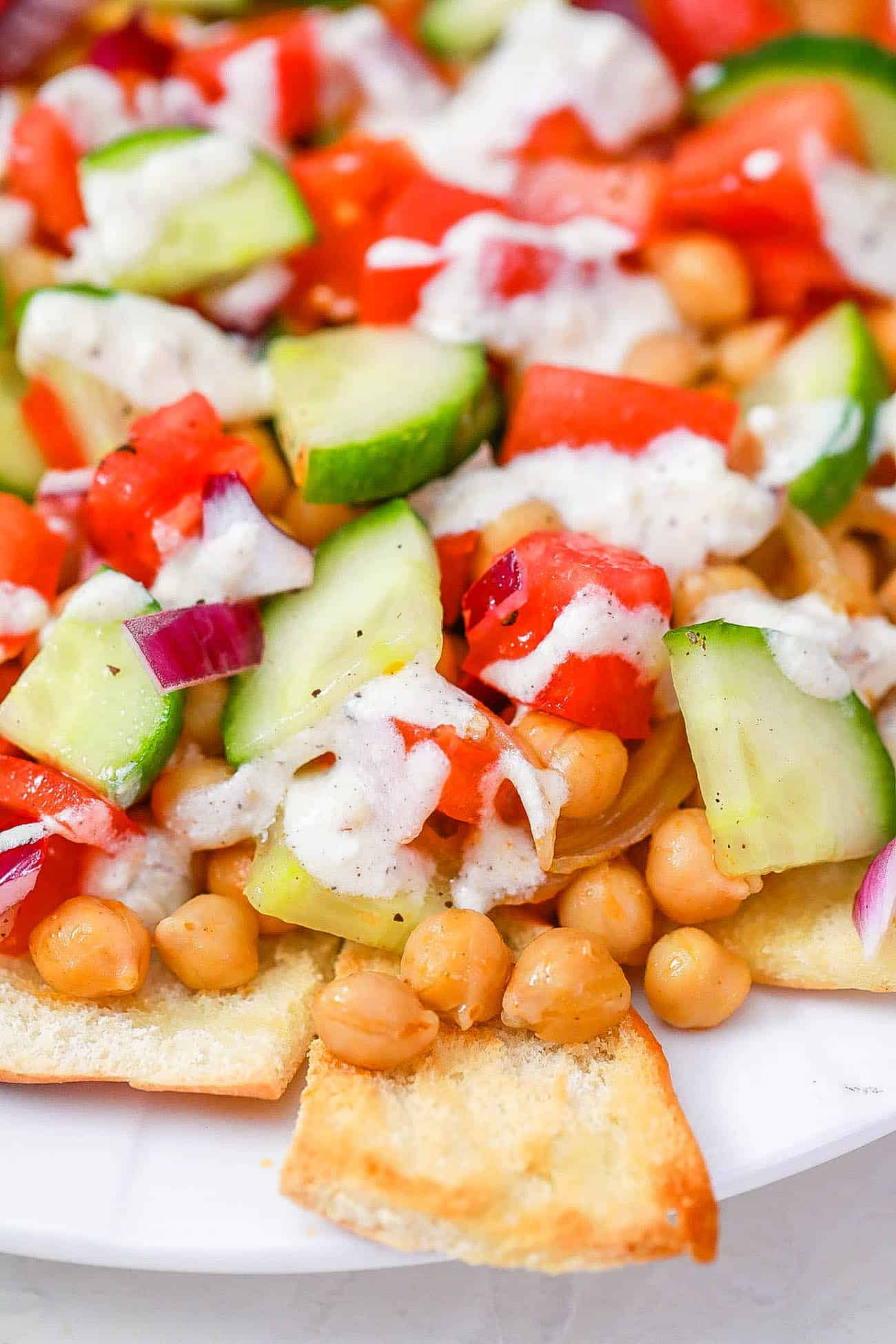 healthy vegetarian greek nachos served on a white plate