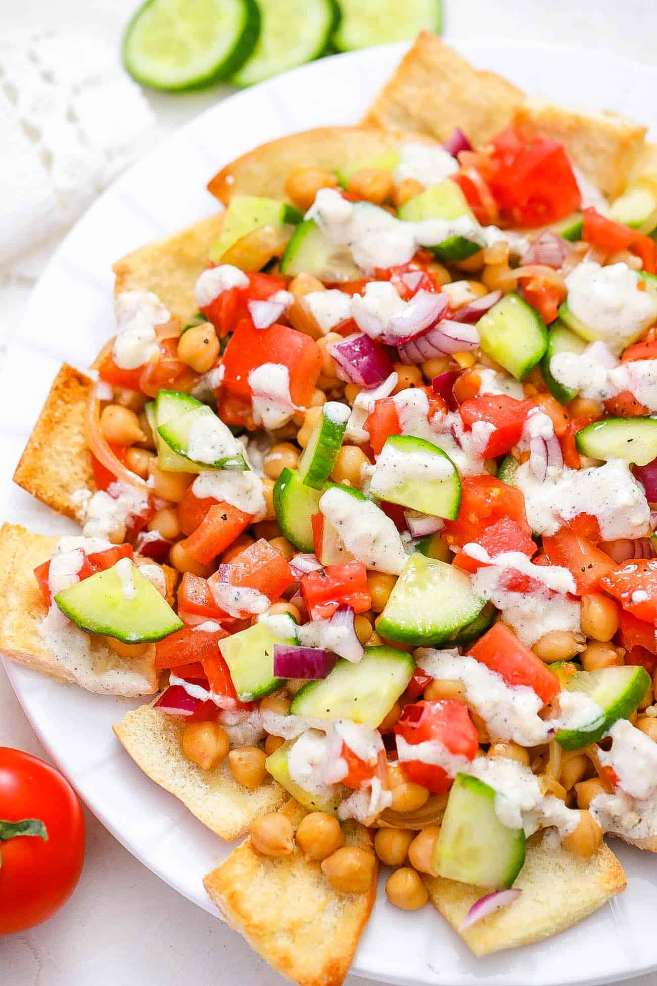 healthy vegetarian greek nachos served on a white plate