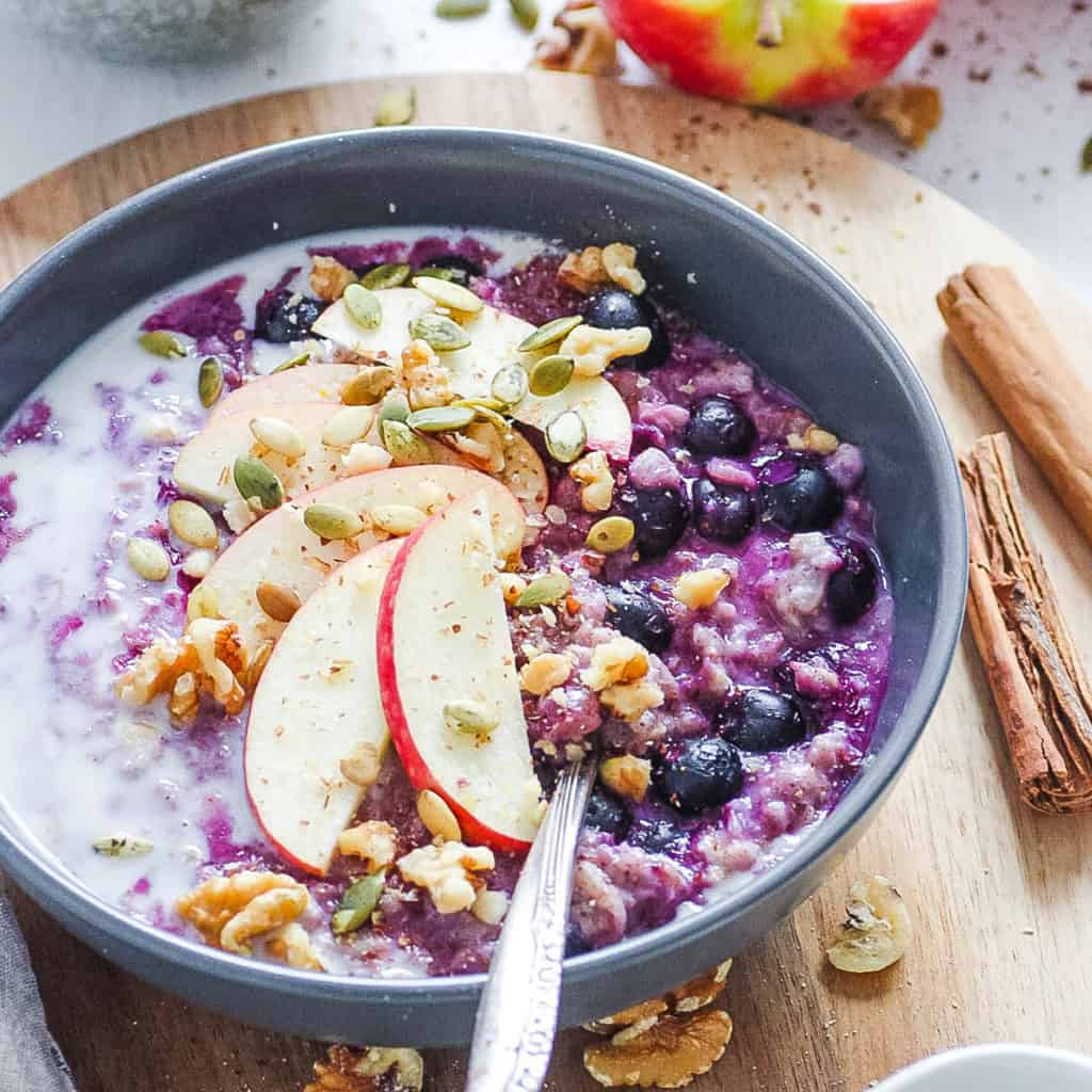 how to make oatmeal taste good - blueberry oatmeal on a wooden cutting board