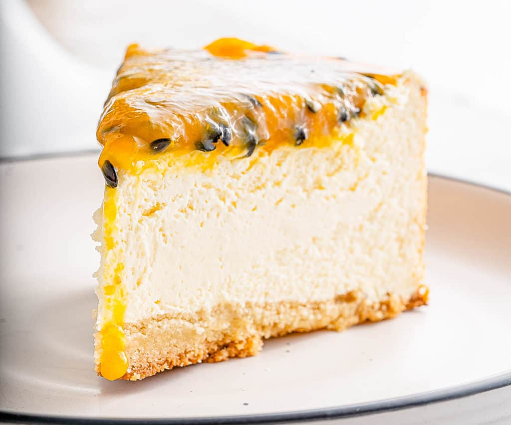 slice of passionfruit cheesecake on a plate