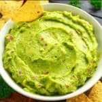 edamame guacamole in white bowl with chips