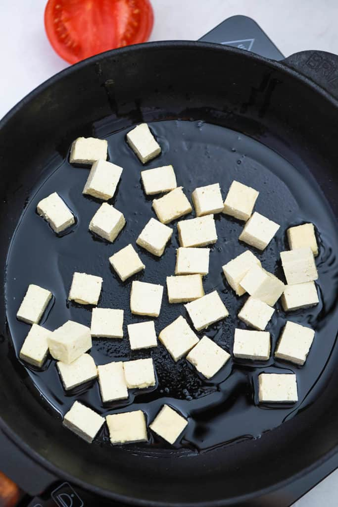 tofu being browned in a pan