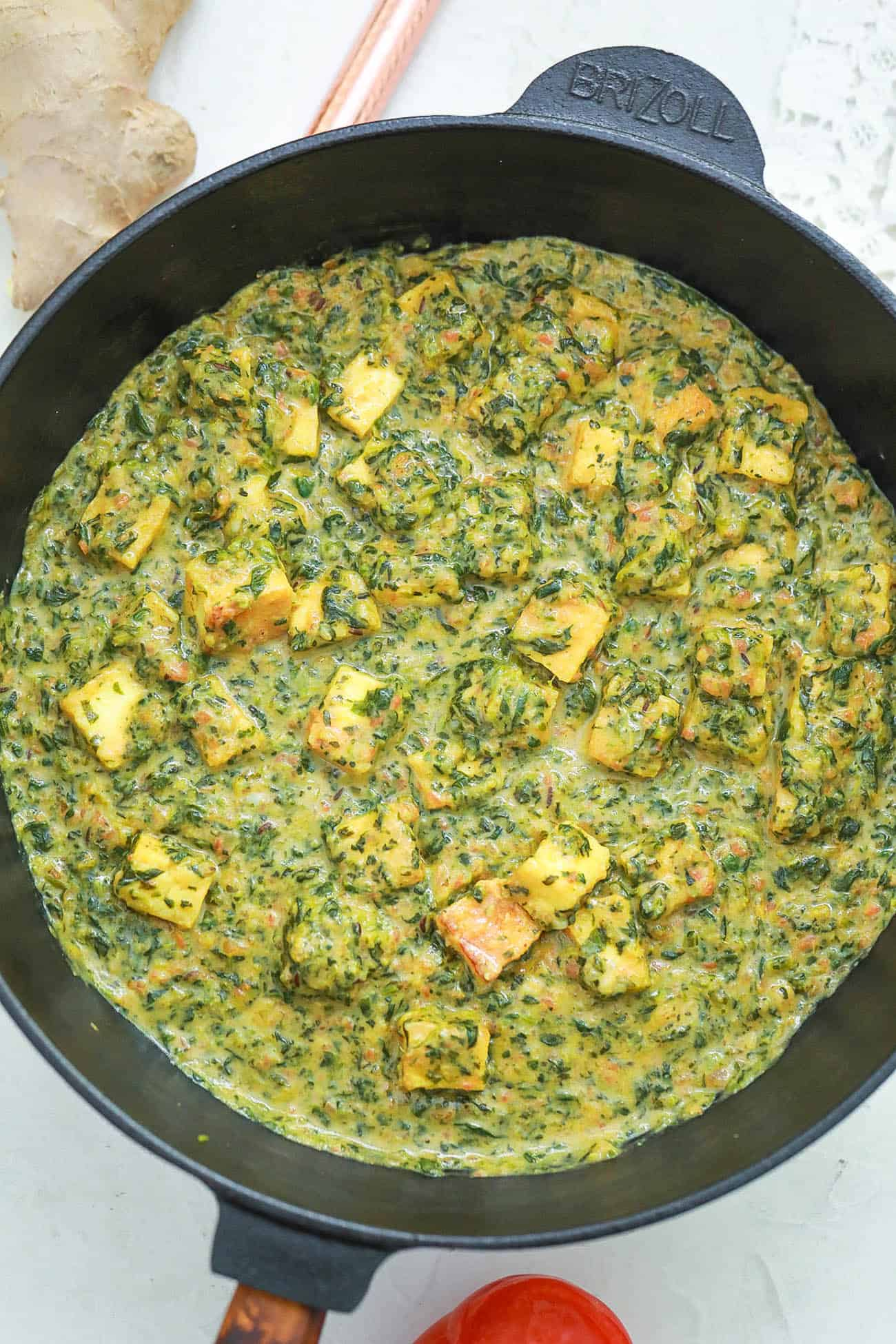 tofu and spinach cooking in a pan
