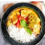 tofu peanut curry with rice in black bowl