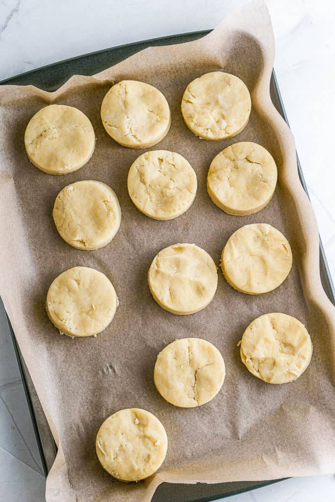 biscuits cut out and on a baking sheet