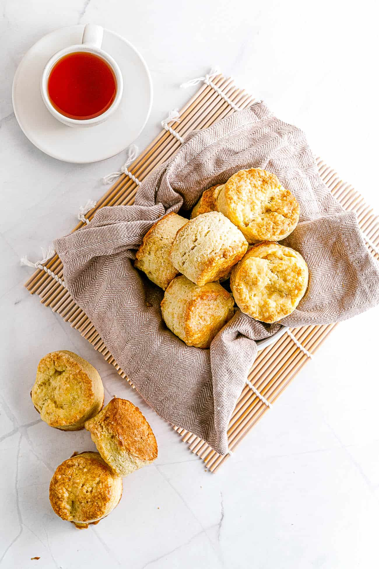 Easy Biscuit Recipe without Baking Powder - biscuits stacked in a bowl and on top of each other