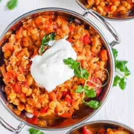 instant pot dal in a stainless steel bowl with a dollop of yogurt on top