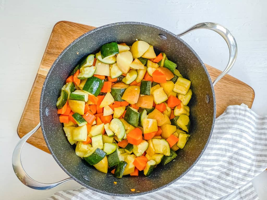 zucchini apples and carrots in a pot