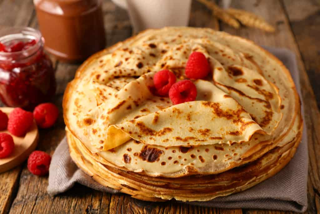 stack of crepe with raspberry and chocolate