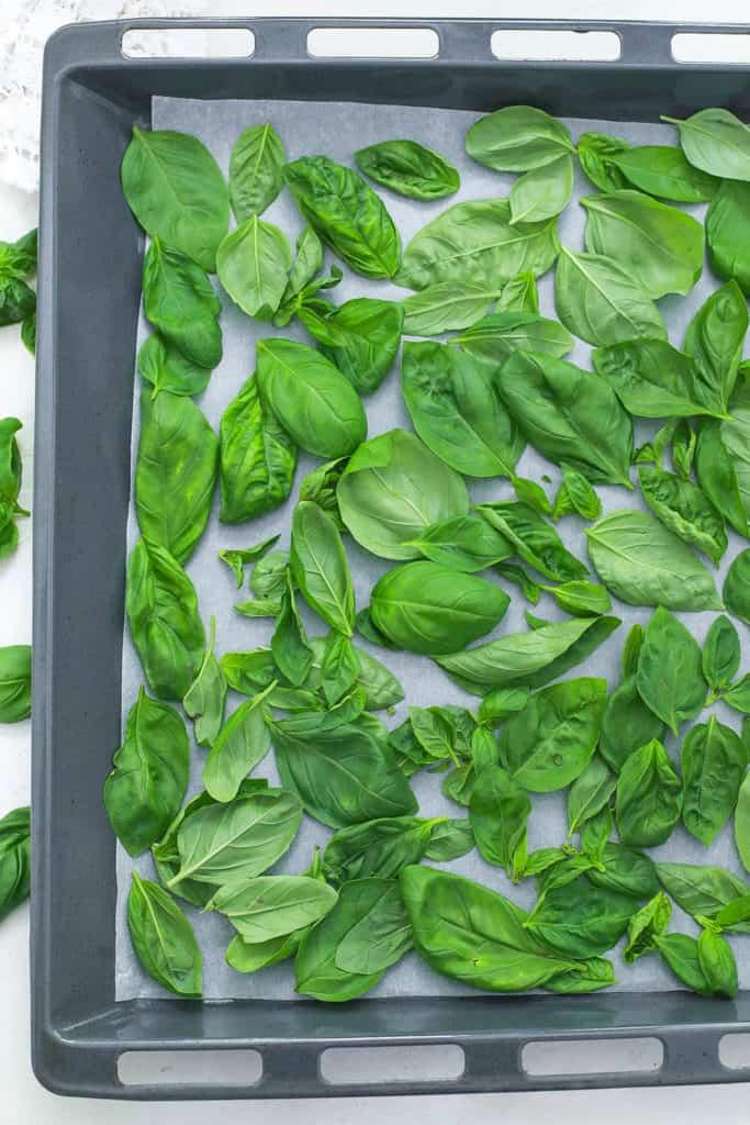 basil leaves on a baking sheet