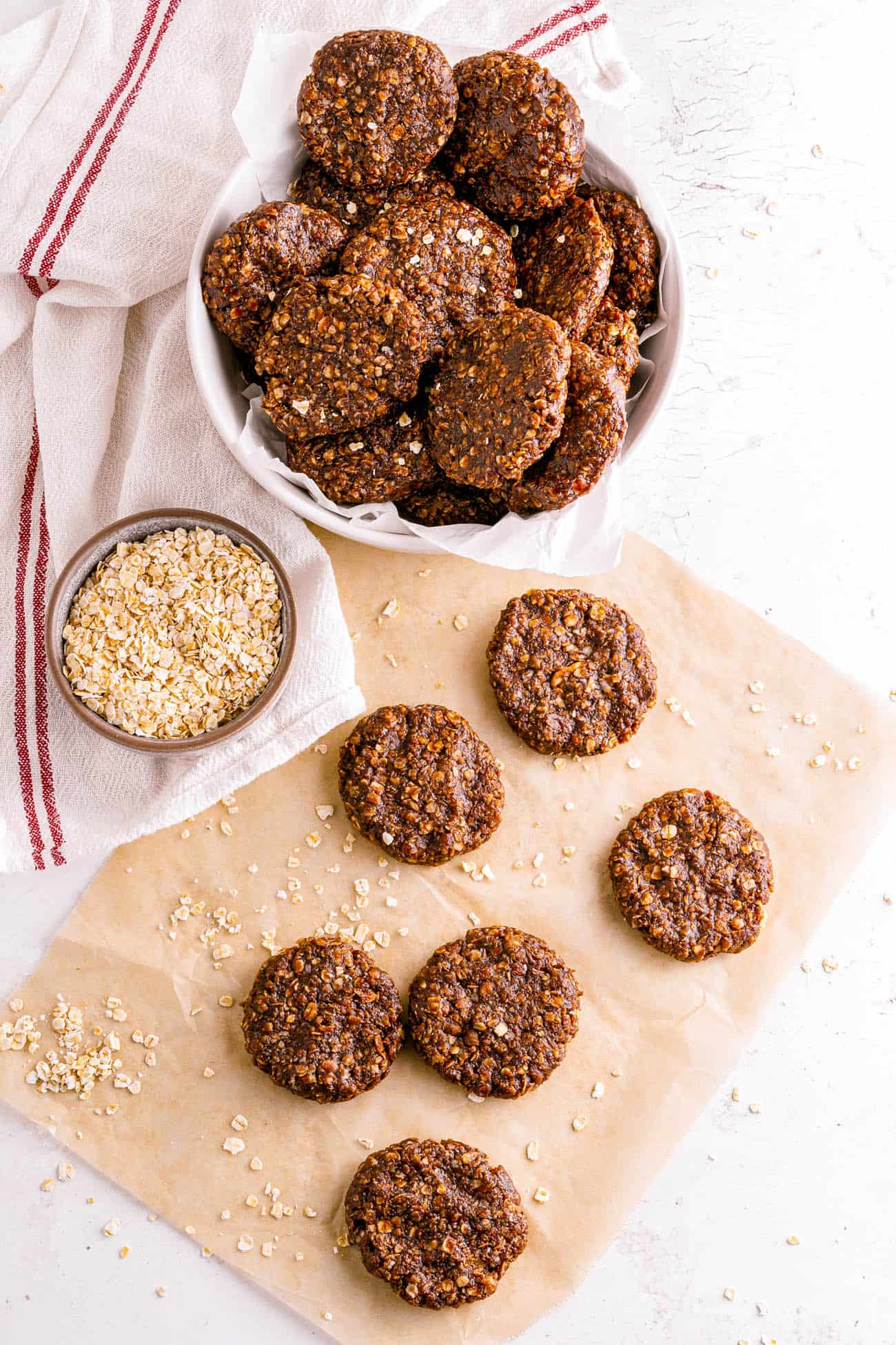 no bake cookies without peanut butter on brown parchment paper with rolled oats sprinkled on top