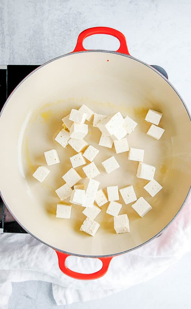 tofu sauteeing in a pot