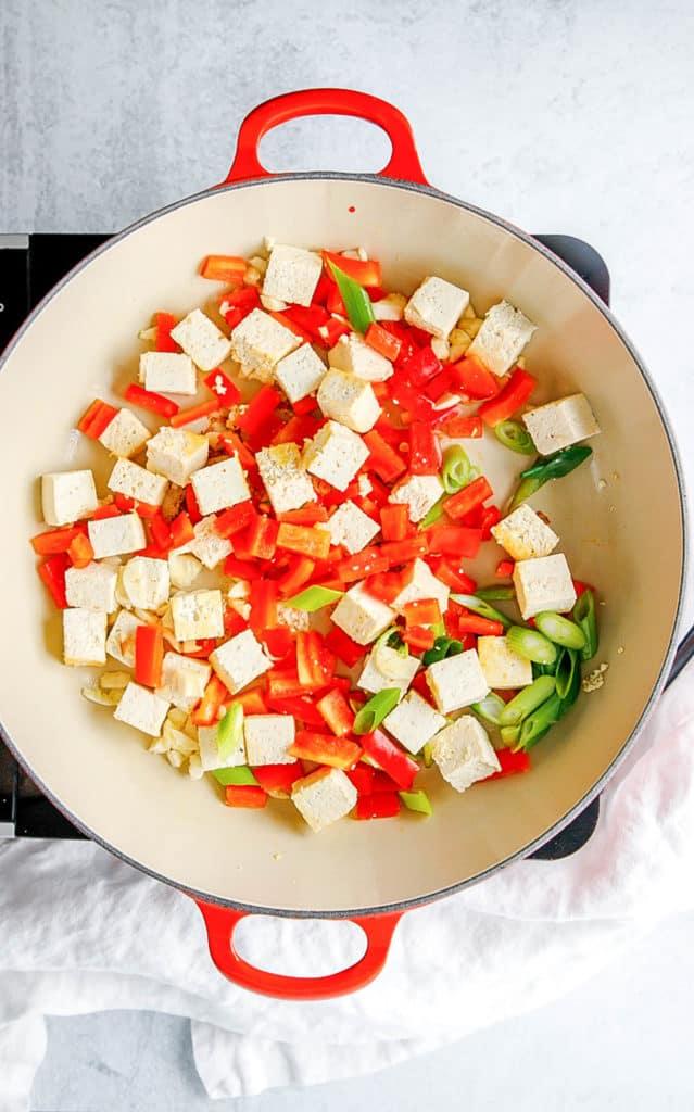 tofu and veggies sauteeing in a pot