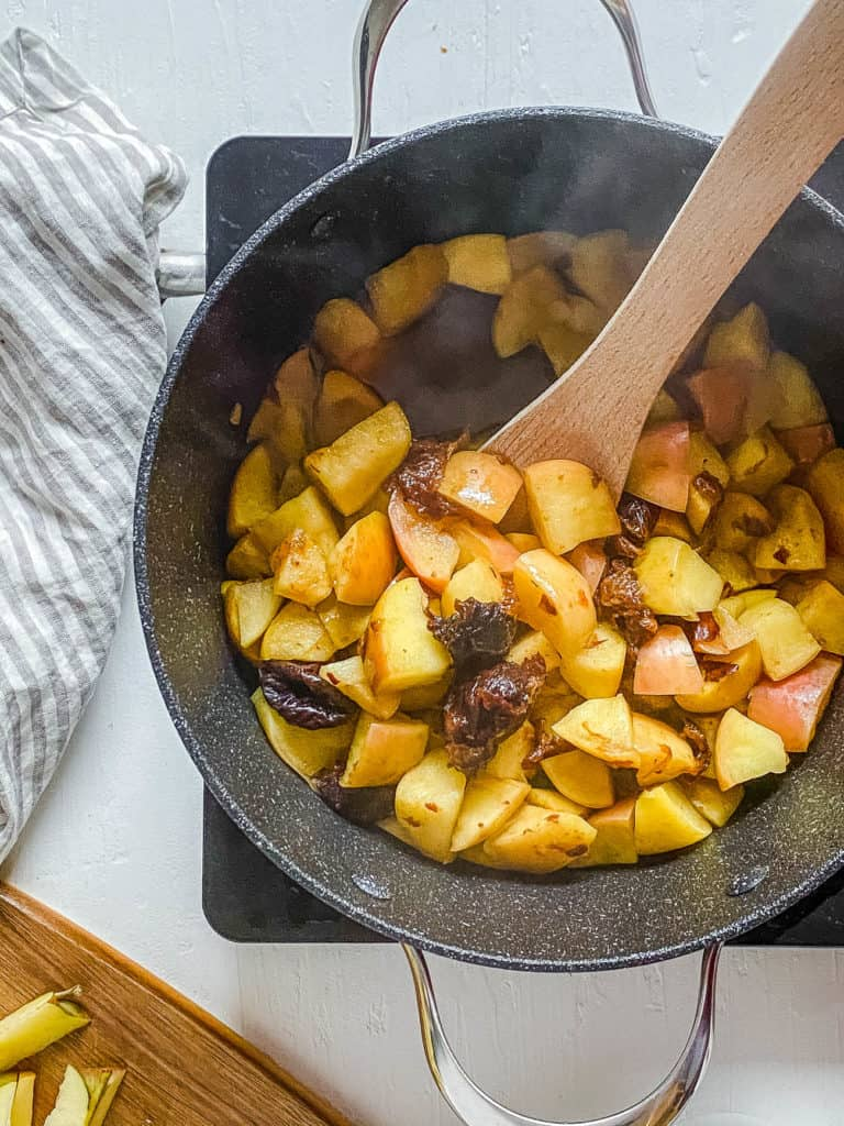 apples and prunes cooking in a large pot