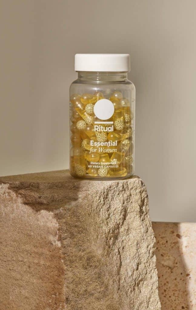 Bottle of Ritual Vitamins for Women on rock.