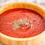Vegan BBQ sauce in brown wood bowl.