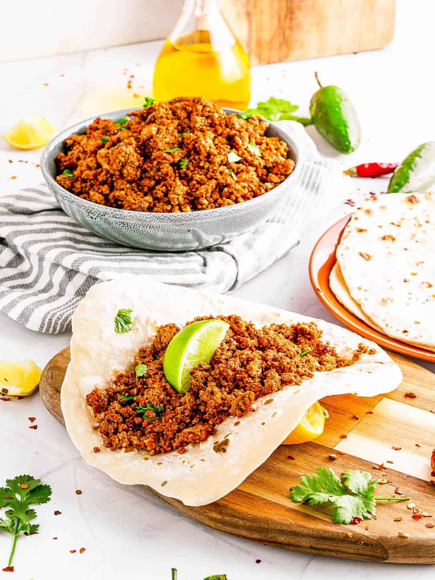 vegan chorizo in bowl with lime and tortilla