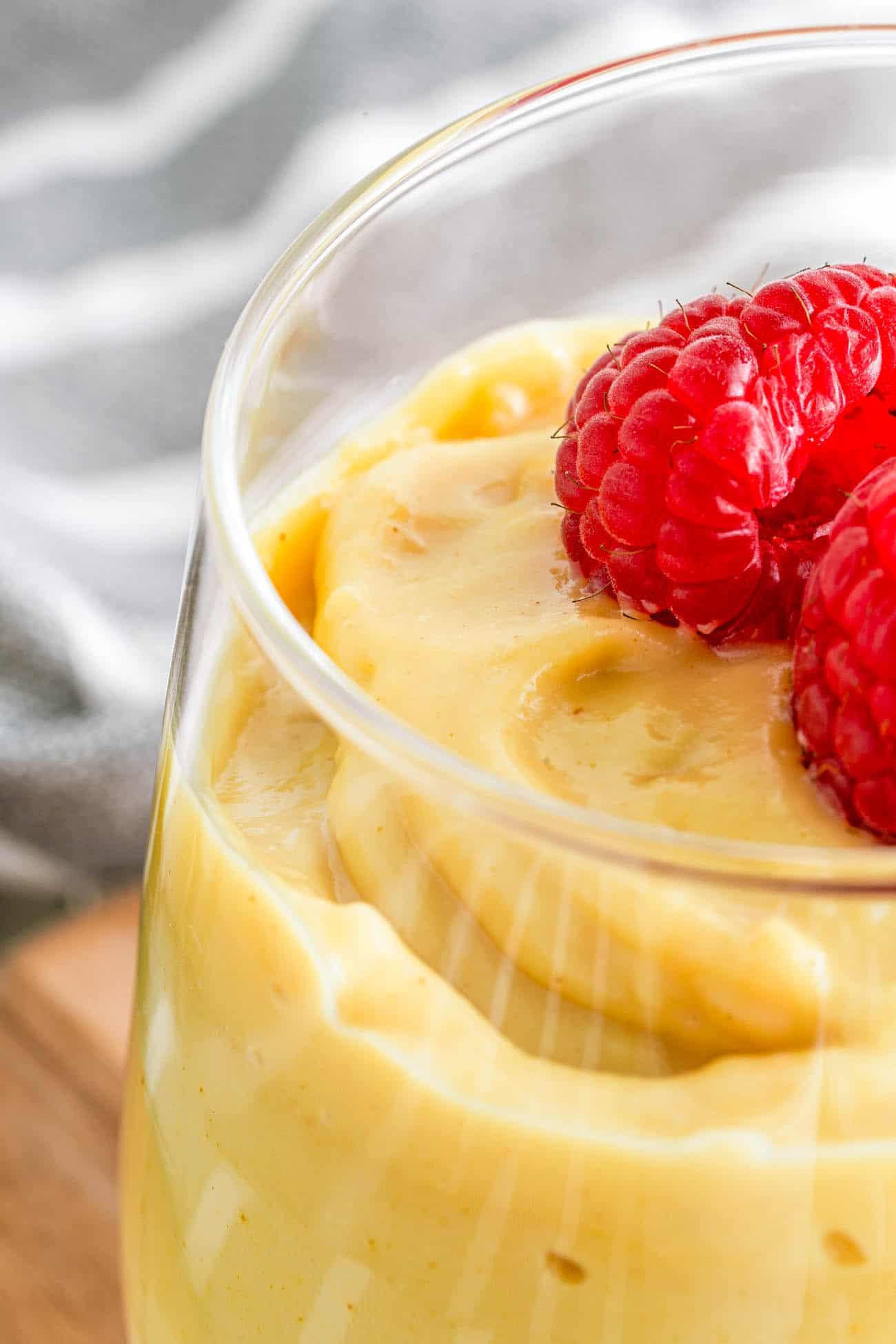 closeup of vegan vanilla pudding topped with fresh berries